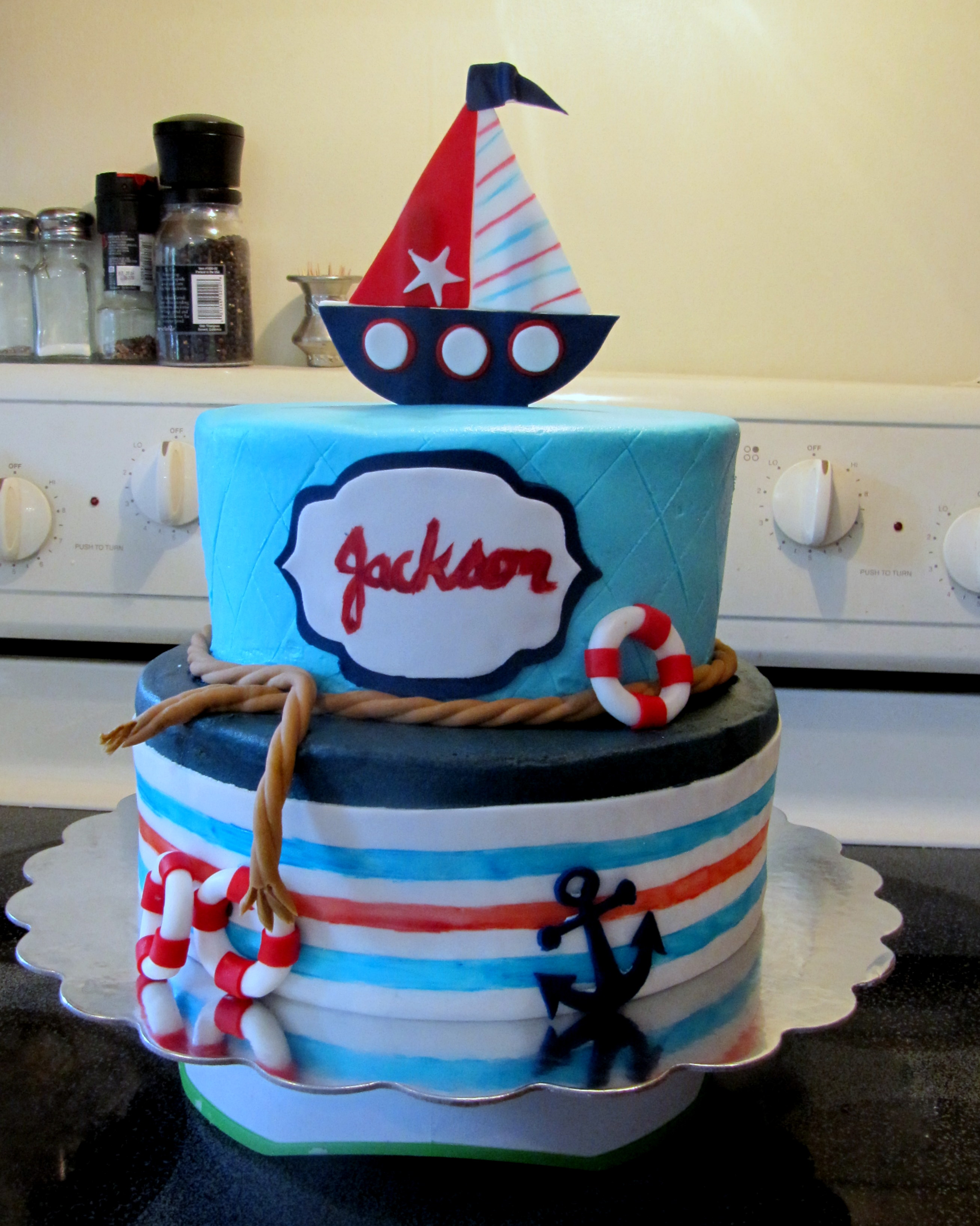 A 10u2033 And 8u2033 White Cake Iced With Vanilla Buttercream Icing. All Decorations  Are Handmade From Fondant!